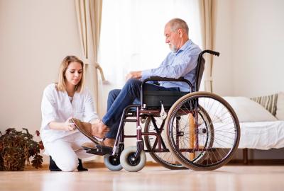 young woman assisting senior man