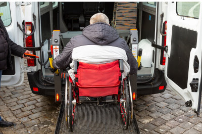 back view of a mini van and a senior man in a wheelchair