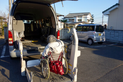 back view of a mini van and a senior woman in a wheelchair