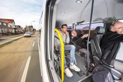 a group of people in a van