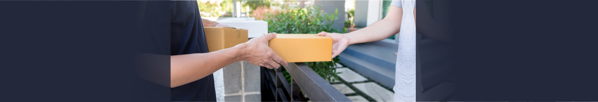 delivery man handing a box to a customer